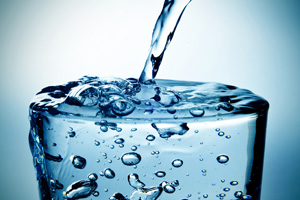 closeup of a refreshing glass of water which is being filled